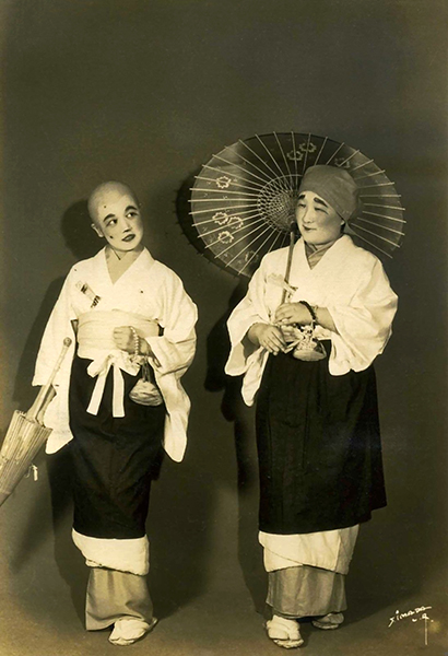 Two Costumed Japanese Performers