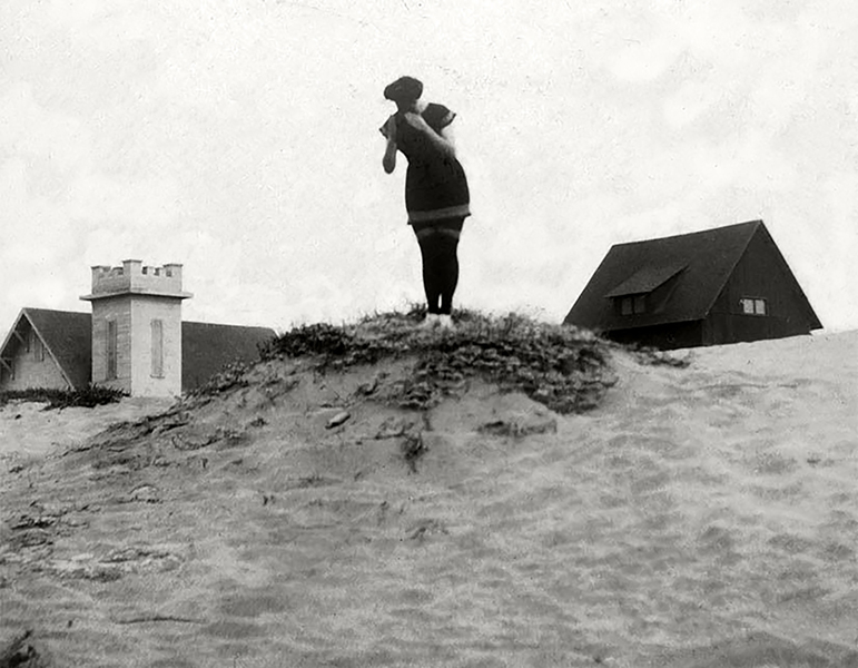 A woman named Ada poses on a sand dune at Manhattan Beach in 1908.