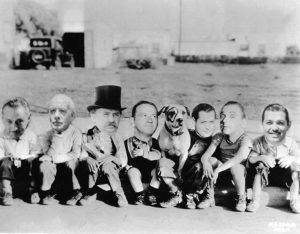 One of the more bizarre images ever to come out of the MGM photo department. Left to right: John Barrymore, Lewis Stone, Jean Hersholt, Wallace Beery, Pete, Robert Montgomery, Lee Tracy and Clark Gable. At least, that's my best guess. (Bizarre Los Angeles)