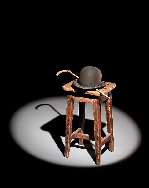 Charles Chaplin's original hat and cane shortly before it went to auction. (Bizarre Los Angeles)
