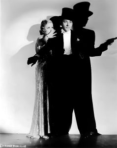 """Joan Bennett hides behind George Raft in """"She Couldn't Take It"""" (1935) Bizarre Los Angeles"""