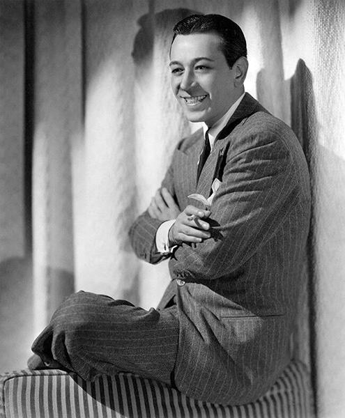 George Raft smiling in 1939 (Bizarre Los Angeles)