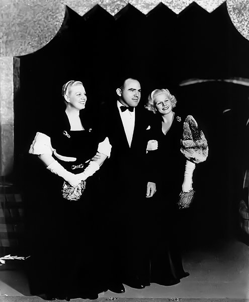 """Jean Harlow with Hal Roach at the premiere of """"Dinner at Eight"""" (1933)."""