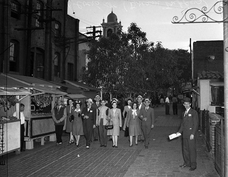 Strolling along Olvera Street in 1949. (OCA) Bizarre Los Angeles