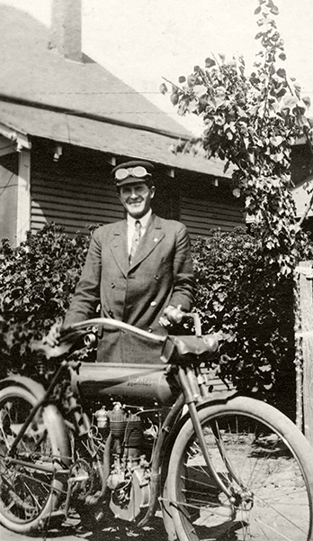 Benjamin Hardin shows off his 1908 Merkel motorcycle in the backyard of widow Anna Cowley's house at 2880 Roxbury Street in Los Angeles. It appears as though this street does not exist by this name anymore. (Bizarre Los Angeles)