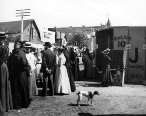 A crowd of moving picture fans in Los Angeles, circa 1900, waiting outside of an early cinema building. While the exact location is unknown, it was located a couple of blocks away from a tall Victorian structure. Was it the old Victorian the American National Bank building on Broadway? Hmmm. (LAPL)