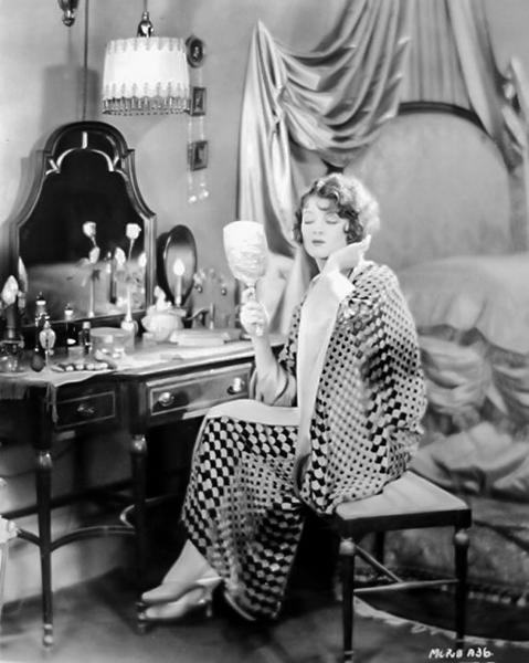 Myrna Loy primping