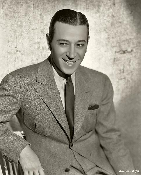 George Raft smiling