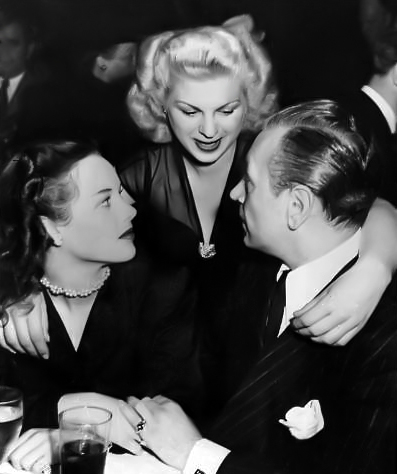 Cleatus Caldwell and George Raft on a date in 1946. (Bizarre Los Angeles)