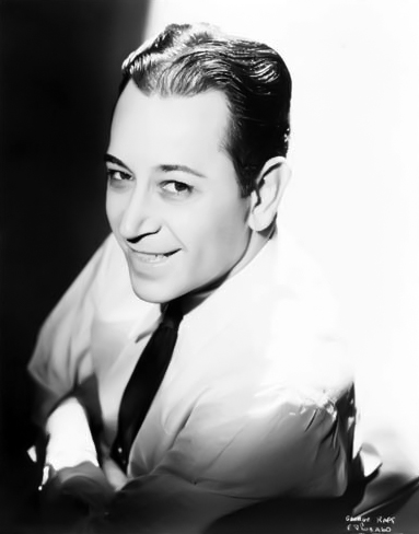 George Raft trying to break with his tough guy typecasting by smiling during portrait sittings. (Bizarre Los Angeles)