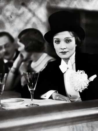 Marlene Dietrich sporting a tuxedo, oversized carnation and top hat. (Bizarre Los Angeles)