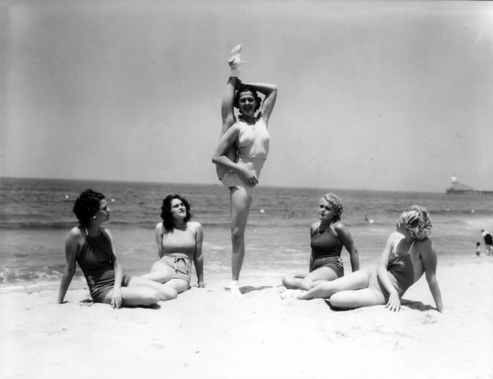 A woman doing a standing splits...on Venice Beach, 1936. Photo was possibly taken around the time of the Miss California Bathing Beauty Contest. (LAPL)