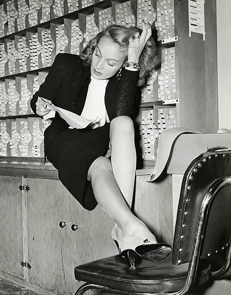 Marlene Dietrich reading fan mail from American servicemen, circa August of 1945. (Bizarre Los Angeles)