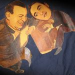 "When this caricature from the Ambassador Hotel's Field & Turf Room went to auction, it was listed as ""songwriters."" I'm going to make an educated guess, here, that the person on the left is Al Dubin and the man at the piano is Harry Warren. Both men would have worked at Warner Bros. (at the time this was painted) and were responsible for the vast majority of songs featured in the Busby Berkeley movies of the early to mid 1930s. Dubin was a lyricist and Warren was a composer. Their songs together included 42nd Street, The Gold Digger's Song (We're in the Money), Lullaby of Broadway, I Only Have Eyes for You, etc. (Bizarre Los Angeles)"