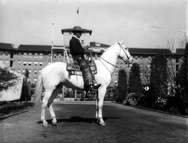 A caballero poses with his horse on the grounds of the Ambassador Hotel during the 1928 Los Angeles National Horse Show. (Bizarre Los Angeles)
