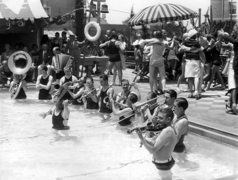 An orchestra entertains inside the Ambassador's Lido swimming pool during an outdoor dance. Photo is undated but appears to be a part of the 1920s jazz age. (Bizarre Los Angeles)