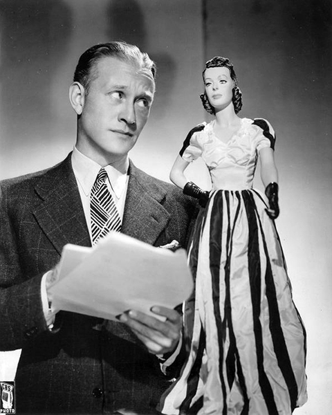 "Conrad Nagel posing with a Loretta Young doll for his CBS Radio Show ""Silver Theatre,"" circa late 1930s-early 1940s. (Bizarre Los Angeles)"