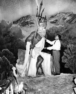 A close-up look at the King Neptune statue that was once part of Santa Monica's Pacific Ocean Park's undersea diaorama. The man posing with the statue was its creator, Maurice Ayers, a Hollywood special effects artist who worked on The Pride and the Passion (1957). Photo: 1958. (LAPL 00096930) Bizarre Los Angeles