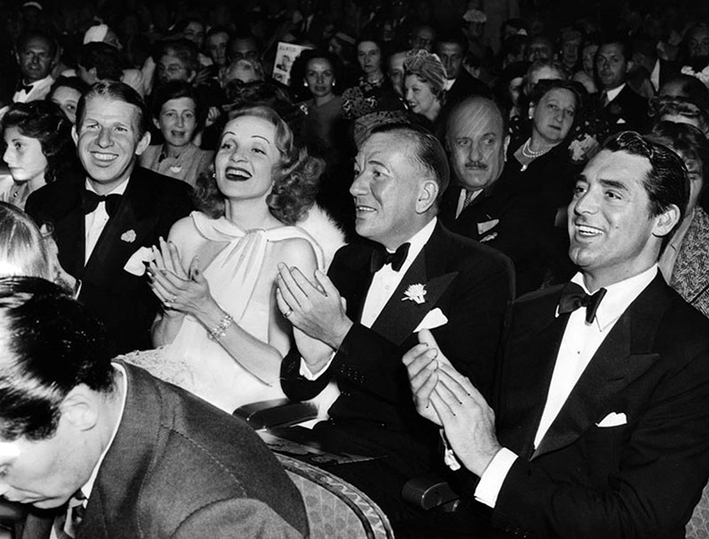 "Marlene Dietrich, Noel Coward and Cary Grant attending an evening of live playlets at the El Capitan Theatre (6838 Hollywood Boulevard) in 1940. The special event, entitled ""Tonight at 8:30"" was a fundraiser for the British Red Cross. (LAPL 00057121) Bizarre Los Angeles"