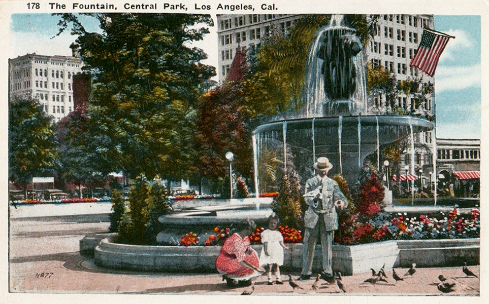 Feeding the pigeons in front of a beautiful, three-tiered fountain in downtown Los Angeles' Central Park.