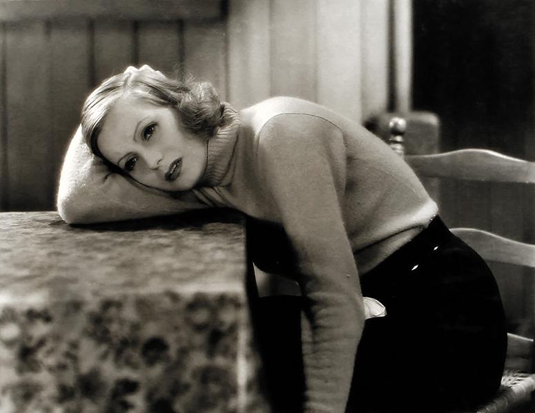 Greta Garbo sits