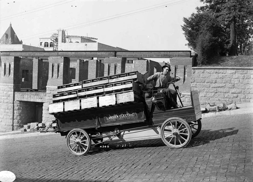 Believe it or not, there were electric powered vehicles in the early 1900s. One manufacturer was Lansden Electric, who introduced its electric powered transport wagon as early as 1904. Lansden was later absorbed into General Motors in the 1910s. By the early 1920s, the electric wagon was retired in favor of gas driven machines. This photo was taken in Los Angeles, circa 1912. Bizarre Los Angeles