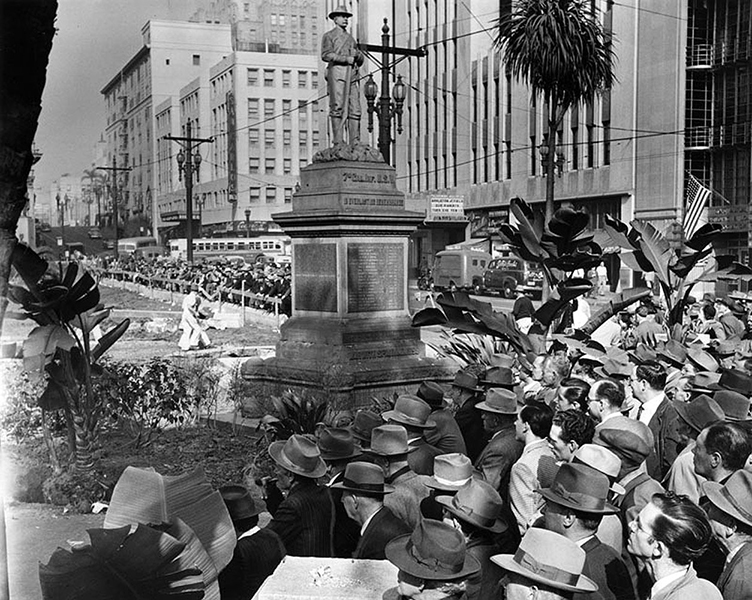 Hundreds of Angelenos looking on as their favorite social gathering place, Pershing Square, is demolished during a 1951-52 makeover. Trees, gardens, water fountains, etc., were removed and the grounds were excavated to make way for an underground parking structure. Afterwards, the city built a new version of Pershing Square on top of the underground structure--only this time, the park had more cement and less foliage. (LAPL 00039788) Bizarre Los Angeles