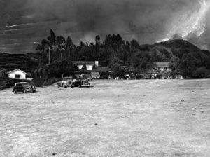 A raging fire in Santa Monica Canyon threatens to consume the Will Rogers homestead in 1938. The house (pictured) was saved, but the flames came close enough to set stables on fire. Fortunately, the stables were saved, and it took hundreds of firefighters to put out the wildfire and save the historic property. (LAPL) Bizarre Los Angeles