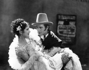 """Billie Dove and Gilbert Roland in """"The Love Mart"""" (1927). Bizarre Los Angeles)"""