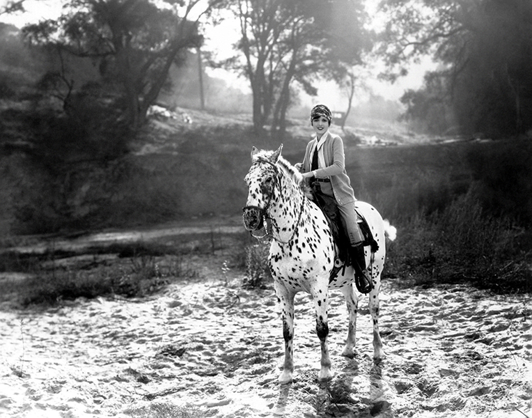 Mary Astor rides a spotted horse in Griffith Park on her way to a breakfast club meeting in 1923. (Bizarre Los Angeles)