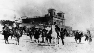 "Santa Monica beach in 1885. Men on horseback are playing a game called, ""catch the ring on the beach,"" which is similar to grabbing the brass ring on a Merry-Go-Round."
