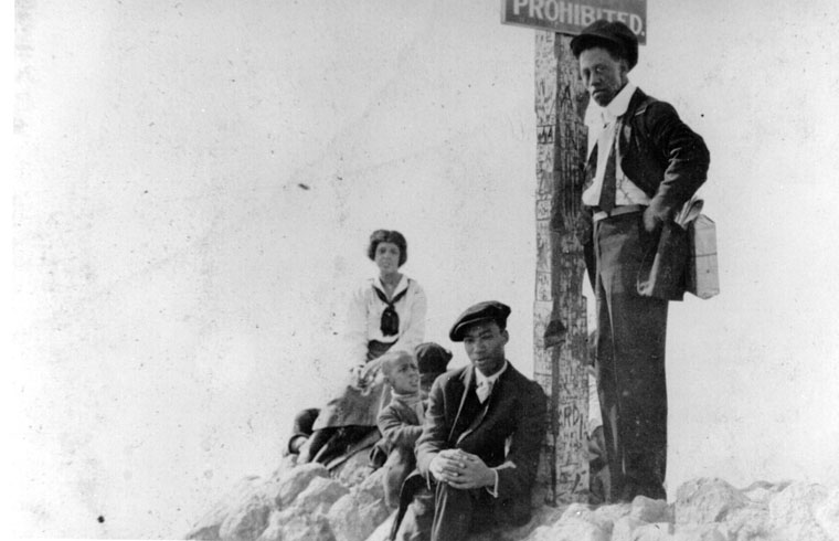"In the early part of the 20th Century, Santa Monica Beach was segregated and the ""Ink Well"" was obviously not the city designated beach for white people. In this 1925 photo, we see three adults and two children at the border of Bay Street and Pico."