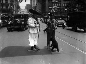 Sometime in the 1920s early 1930s, a shriner, clown and a bear cub decide to have a photo op in the middle of Olive Street. (Bizarre Los Angeles)