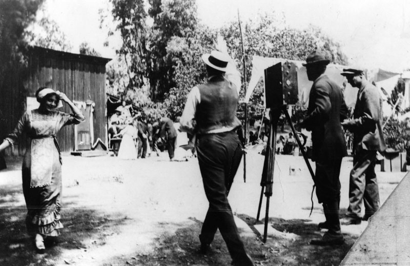 Dorothy Davenport is far left as cameramen ready themselves to shoot a silent movie scene in Edendale. This set is located at the Bonadiman farm (no longer around), near what is now Benton Way in Silver Lake. Photo circa 1915. (Bizarre Los Angeles)