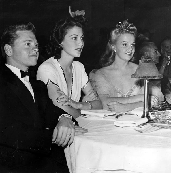 Ciros restaurant - Ava Gardner & Mickey Rooney with young Paramount Studios starlet Ann Harris. Photo by JOSEPH JASGUR. Bizarre Los Angeles.