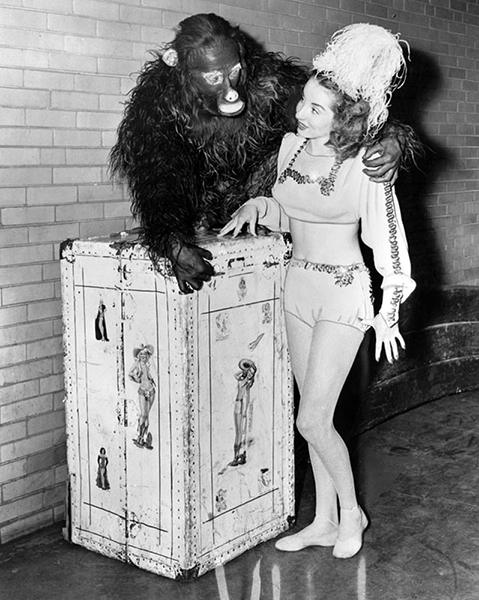 "Vicki Berosini of the ""High Wire Berosinis"" poses with ""Natal the Monkey Man"" backstage at the Shrine Auditorium in 1949. The act was part of the Polack Bros. Circus, better known as the ""Shrine Circus."" LAPL: 00099448. Bizarre Los Angeles"