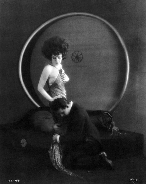 "Iconic photo of Rudolph Valentino kneeling at Alla Nazimova's feet in the 1921 version of ""Camille."" Bizarre Los Angeles"
