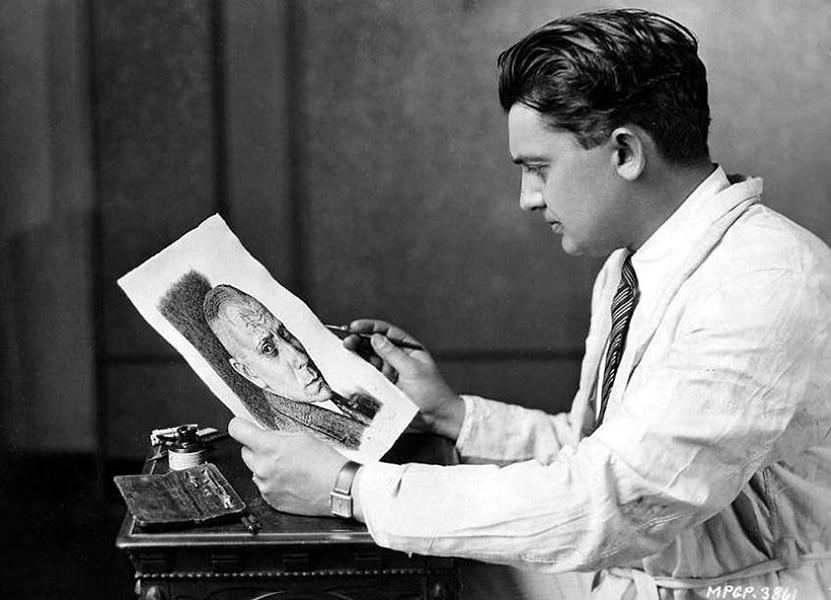 Jean Hersholt showing off his artistry in drawing Erich Von Stroheim. (Bizarre Los Angeles)