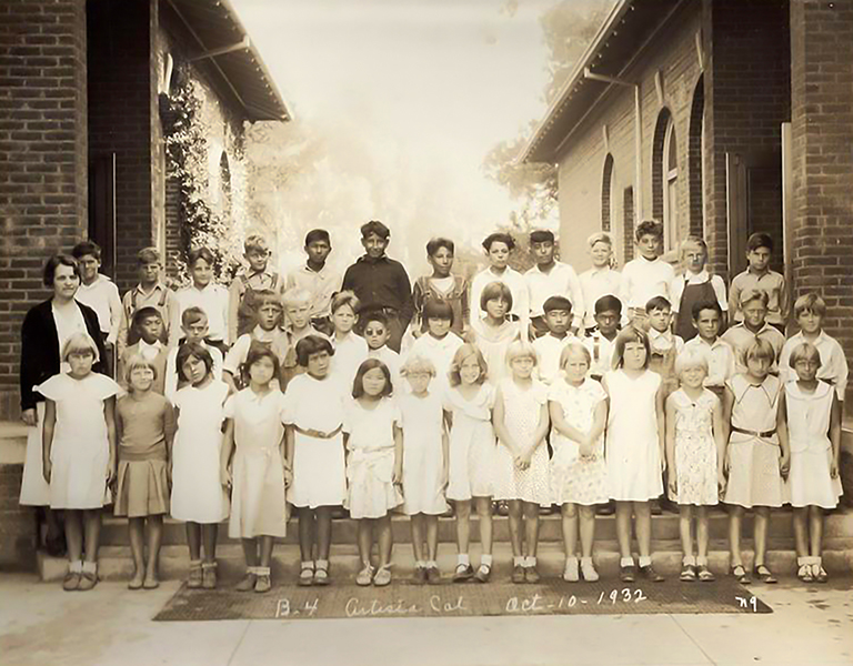 Fourth graders posing for a class photo in Artesia, California, circa 1932.