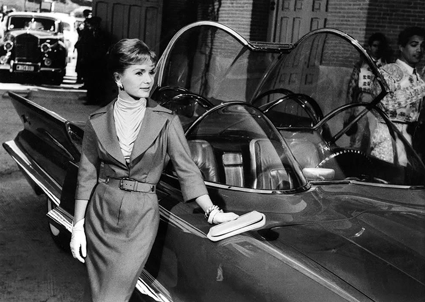 """Debbie Reynolds posing with a Lincoln Futura in the film """"It Started with a Kiss"""" (1959). A modified version of the car would later become more famous as the Batmobile. (Bizarre Los Angeles)"""