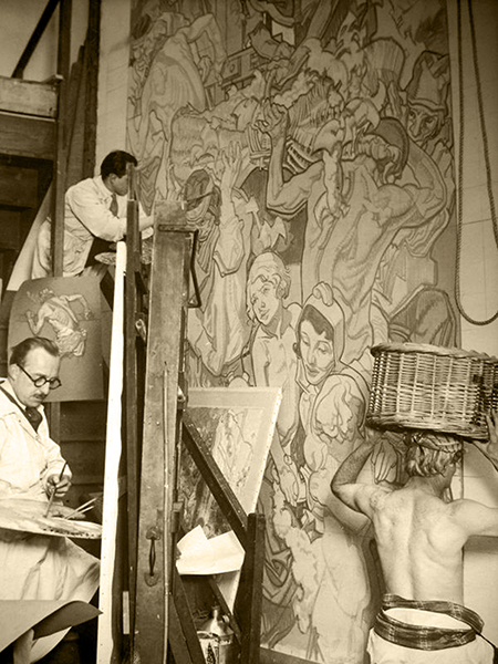 Dean Cornell (far left), and an assistant working on a mural for the Los Angeles Public Library from his Kensington Studio in London, circa 1930. Note the model with the basket on his head. (Bizarre Los Angeles)