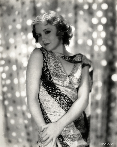 """""""Nancy Carroll has a quick, bright smile and a little habit of pushing a great lock of hair out of her eyes. She has very decided likes and dislikes. She is ambitious and hardworking. When posing for still pictures she always uses a mirror."""" -- Morning Chronicle (November 2, 1930) Bizarre Los Angeles."""