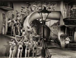 """Chorus girls for the musical number """"Boulevard of Broken Dreams"""" in Moulin Rouge (1934). Lucille Ball and Barbara Pepper are among the girls. I'm thinking Lucy and Barbara are on the very front row: Lucy is far left and Barbara is directly to the right of her. What do you think? (Bizarre Los Angeles)"""