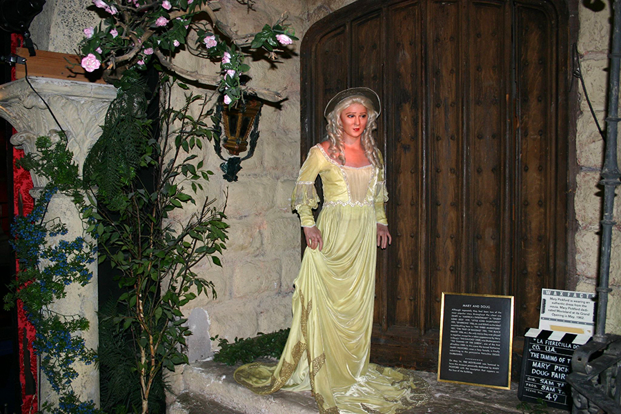 Mary Pickfordfrom the defunct Movieland Wax Museum in Buena Park. The sign says that Pickford donated the costume for the exhibit in 1962, which depicts her in a scene from Taming of the Shrew. (Bizarre Los Angeles)
