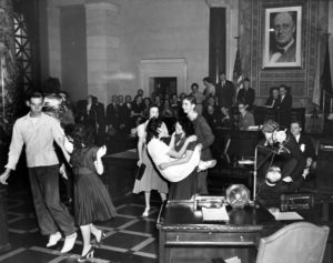 """September 7, 1938. Jitterbugging juveniles disrupt the L.A. City Council to promote the American Legion's """"Jitterbug"""" contest at Gilmore Stadium. (Bizarre Los Angeles)"""