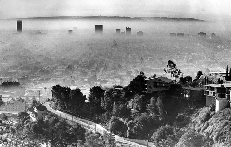 """Remember when Lost Horizon was a movie? Now it's Los Angeles during a smog alert."" -- Anonymous. Photo is from 1964 (Photographer: Mike Sergieff / LAPL 00060078) Bizarre Los Angeles"