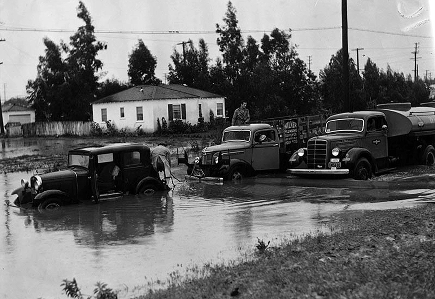 A stalled car on Venice Blvd. at Greenfield Street near Culver City. Heavy rains flooded that section around Christmas 1940. Bizarre Los Angeles