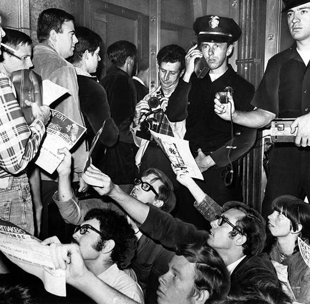 "According to the Los Angeles Public Library, ""Draftees, at left, walk into Armed Forces induction center at 1031 S. Broadway while anti-Vietnam war demonstrators, in foreground, attempt to distribute pamphlets to them. Earlier, police arrested 19 demonstrators who assertively refused to disperse after having blocked doorway to the center."" The photo was taken in 1967. (Photographer: Art Worden / LAPL 00084118) Bizarre Los Angeles"