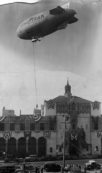 "A zany publicity stunt from 1931. A Goodyear blimp named the ""Volunteer"" hovers above the Evening Herald building, located at 1111 South Broadway, to pick up a bundle of newspapers for a special delivery at city hall. (LAPL) Bizarre Los Angeles"