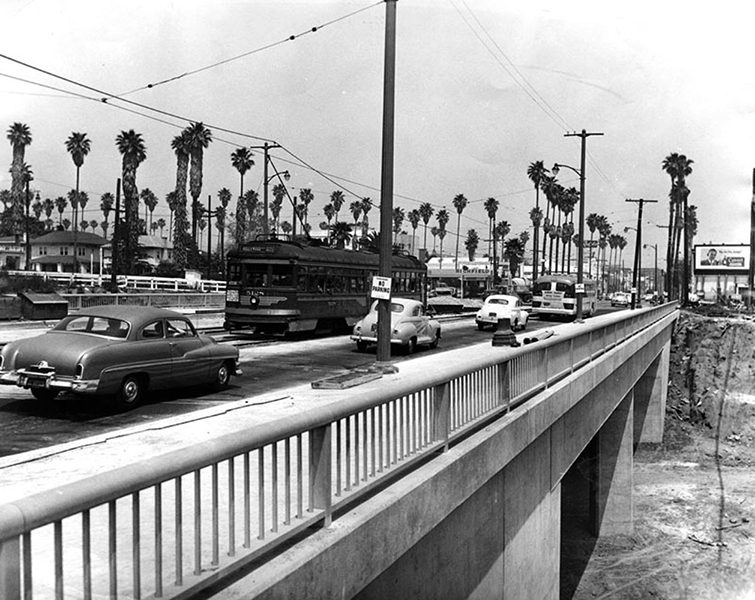 Cruising over the Hollywood Boulevard bridge near Bronson in 1952. The Hollywood Freeway (101) was still under construction at the time. (LAPL)